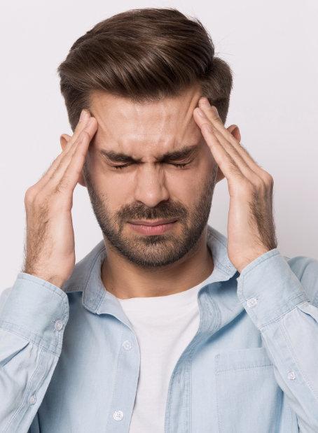 Caucasian Male having a Headache